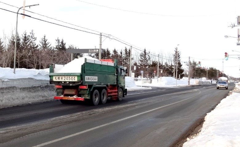 Truck clearing snow on Japanese road